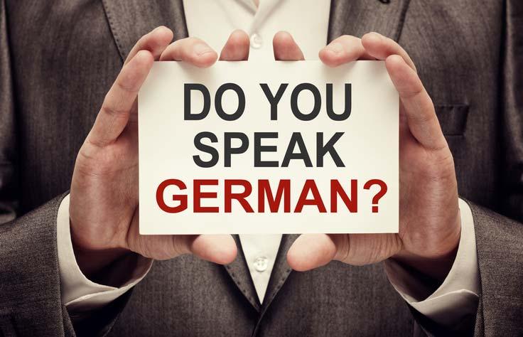 Einstufungstest Deutsch. Auf einer Tafel steht geschrieben: Sprechen Sie Deutsch?