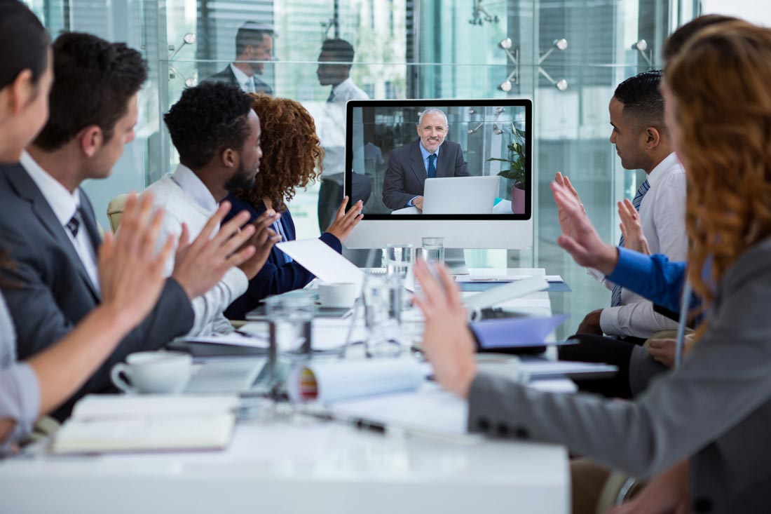 A video conference or an online group course with a teacher and a group of English students