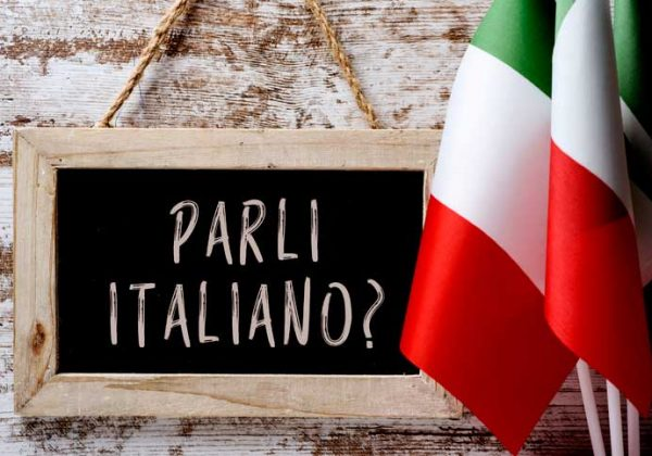 "On a tablet i t says ""Parli italiano?"", Do you speak Italian?"